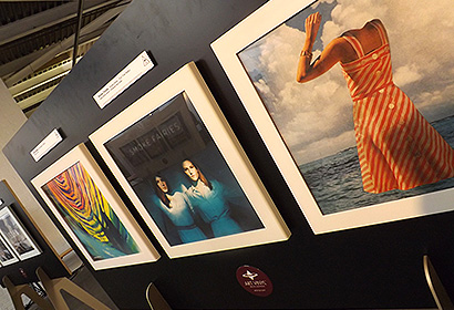Framed vinyl records in an exhibition for the best record sleeves of 2014